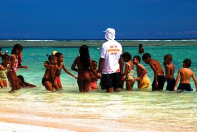 Schwimmschule am Strand in Flic en Flac